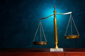 Justice scale on blue background