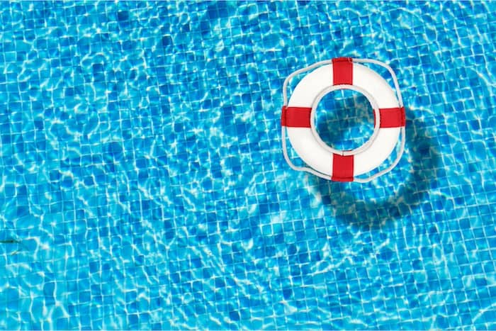 A Coast Guard approved Ring Buoy floats in a pool