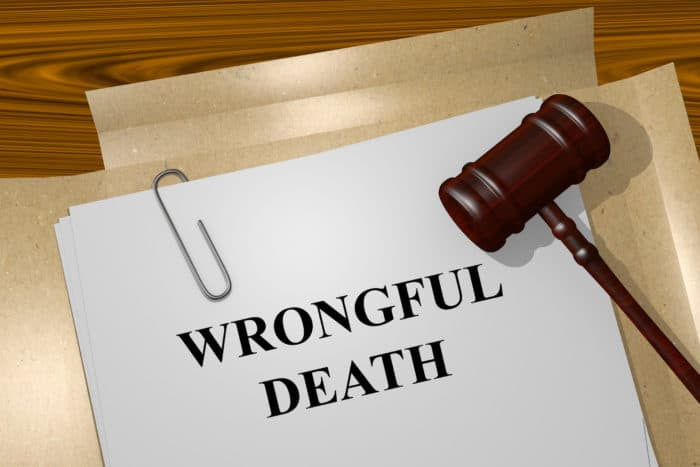 A legal gavel rests on a stack of Wrongful Death legal documents