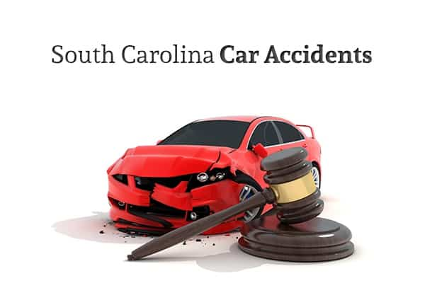"A red car that has been in a wreck sits behind a gavel, under the words ""South Carolina Car Accidents"""