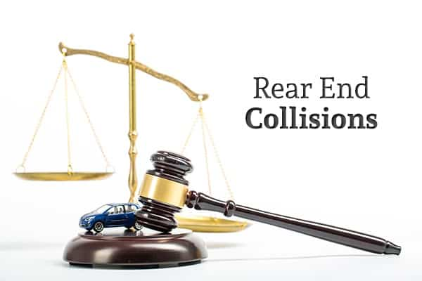 "A toy car sits on a gavel base beside a gavel with scales in the background and the words ""Rear End Collisions"""