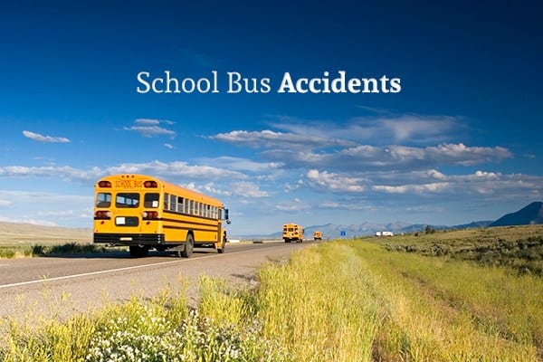 "A country road with two school buses driving off into the distance beneath the words ""School Bus Accidents"""