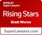 Red badge indicating that Brett Woron is rated one of the Rising Stars by SuperLawyers.com