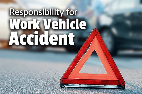A car accident with a caution sign infant of it with the words, responsibility for work vehicle accident.